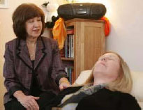 Rhoda Kopy (left) works with one of her clients,in Kopys Toms River practice, called Hypnosis for Women